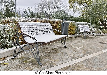 bench with snow in a park