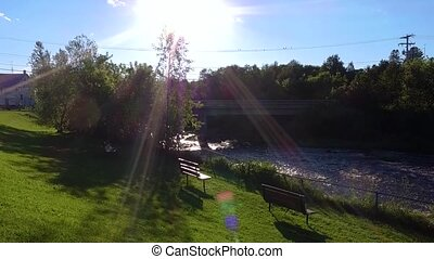 Filmed at a river barrage surrounded by park areas, in Quebec Canada. Filmed on a beautiful summer day with perfect blue sky, with some lens flares.