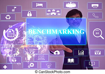BENCHMARKING concept  presented by  businessman touching on  virtual  screen ,image element furnished by NASA