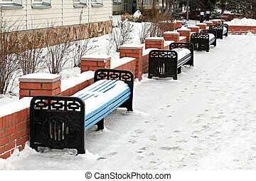 Benchs in winter. - Benchs are covered snow by a winter...