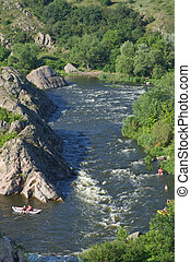 Bend of the Southern Bug river called Integral. Famous place for rafting in Ukraine. A steep bend in a fast river. Rocky coast.