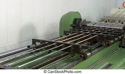Bending and cutting metal copper pipes tubes on industrial...