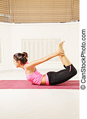 Bending back yoga pose