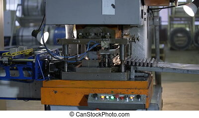 Bending Metal, piece of metal is bended by a machine - Dolly...