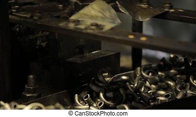 Bending Metal, piece of metal is bended by a machine. Metal...