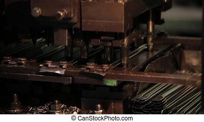 Bending Metal, piece of metal is bended by a machine. Metal tableware manufacturing, piece of metalware