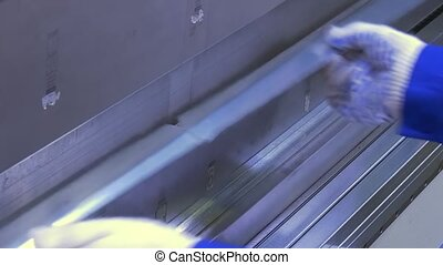 Bending of aluminum profile on industrial machine in...