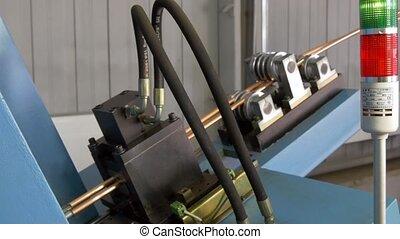 Bending of metal copper tubes on industrial machine in...