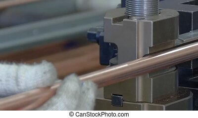 Bending of metal tubes on industrial machine in factory....