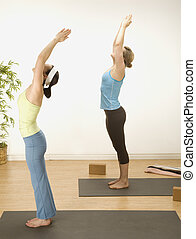 Bending over backward for Yoga - woman in a traditional yoga...
