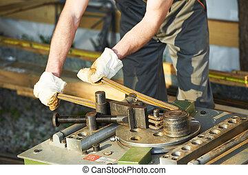Bending reinforcement metal rebar rods - close-up worker...