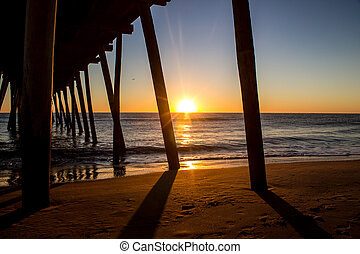 Beneath the Pier - A view beneath a fishing pier with the...