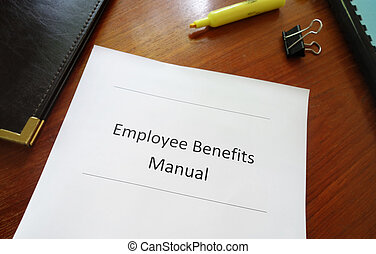 Employee Benefits Manual on an office desk
