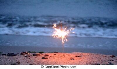 Bengal fire burning on the sea beach