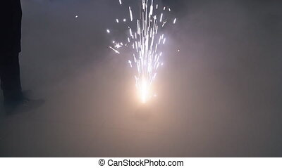 Bengal fire among smoke close-up slow motion