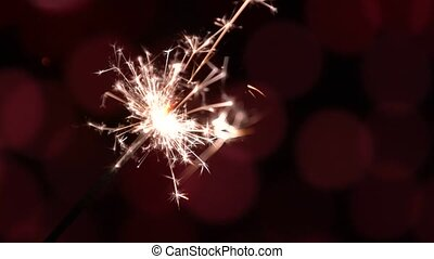 Bengal fire, Christmas sparkler on holiday bokeh background, high quality 4K 3840x2160