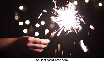 Bengal fire, sparkler and colorful bokeh christmas, new year background.