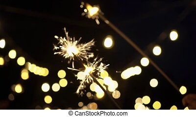 Bengal fire sparklers slowmotion outdoors