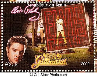 BENIN - CIRCA 2009 : stamp printed in Benin - Elvis Presley against her LP and Graceland, circa 2009