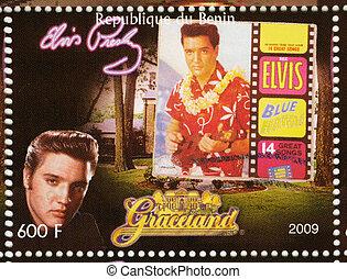 BENIN - CIRCA 2009 : stamp printed in Benin - Elvis Presley against her LP Blue Hawaii and Graceland, circa 2009