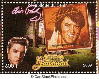 BENIN - CIRCA 2009 : stamp printed in Benin - Elvis Presley against her LP Elvis in Memphis and Graceland, circa 2009