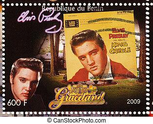 BENIN - CIRCA 2009 : stamp printed in Benin - Elvis Presley against her LP King Creole and Graceland, circa 2009