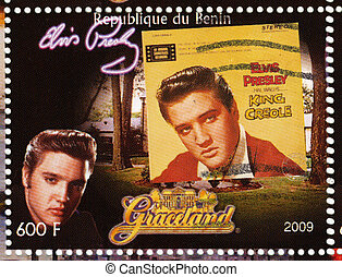 BENIN - CIRCA 2009 : stamp printed in Benin - Elvis Presley against her LP King Creole and Graceland, circa 2009