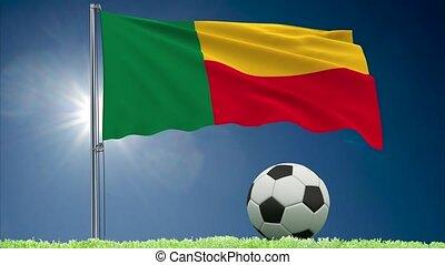 Benin flag fluttering and football rolls - Flag of Benin...