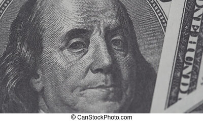 Benjamin Franklin on one hundred dollars bill slow rotating. Dollars, close up in 4K video.