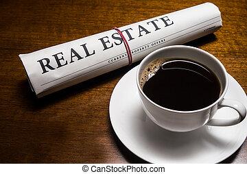 bens imóveis, jornal, xícara café