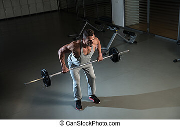 Bent Over Row Workout For Back - Man Doing Heavy Weight...
