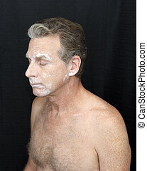 Bentonite Liquid White Clay Mask Worn by a Man