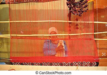 Berber woman weaving a carpet, Mococco Africa