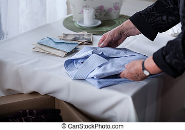 Bereaved female tidying things - Close up of bereaved female...