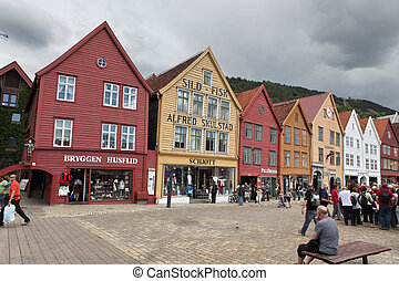 BERGEN, NORWAY - CIRCA JULY 2012: Tourists and locals stroll...
