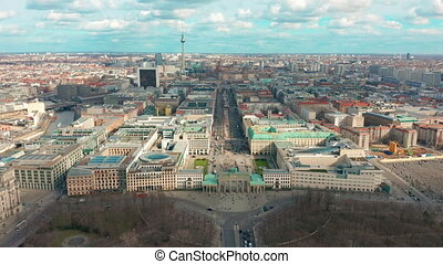 Berlin Brandenburg Gate aerial view with city traffic.