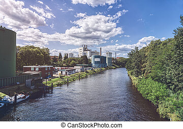 Berlin canal in summer with industrial plants
