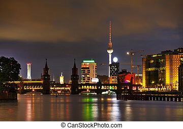 Berlin cityscape with Oberbaum bridge in the evening