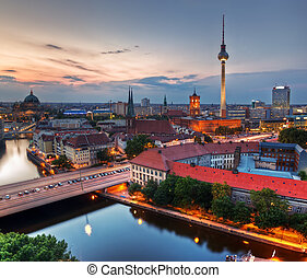Berlin, Germany rooftop view on Television Tower, Berlin Cathedral, Rotes Rathau and the River Spree - the major landmarks at late sunset