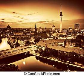 Berlin, Germany major landmarks at sunset in gold tone -...