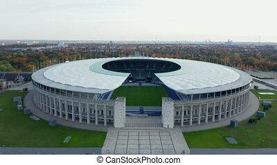 Berlin, Germany Soccer Football Stadium Establishing Shot, slow Aerial slide right on beautiful day in Fall 4K