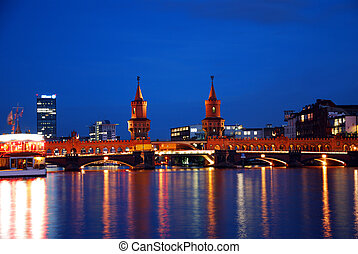 berlin oberbaumbruecke bridge by night with vibrant colors...