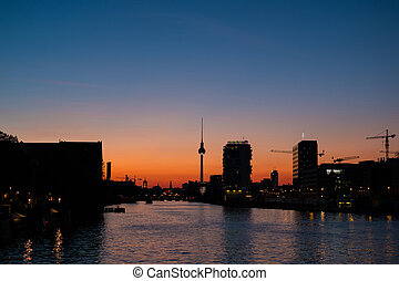 Berlin skyline sunset sky and tv tower at river spree