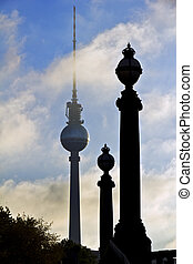 berlin television tower with two similar pillars of a bridge