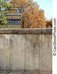 Berlin wall Germany with guard tower in autumn