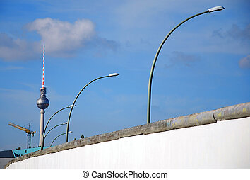 berlin wall with east german street lights and tv-tower