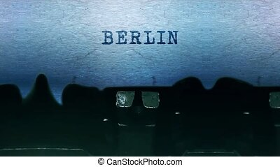 BERLIN Word closeup Being Typing and Centered on a Sheet of paper on old vintage Typewriter mechanical 4k Footage Background Animation.