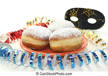 a plate of donuts and carnival decoration