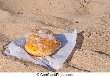 Berliner ball - berliner ball on a sandy beach in Algarve,...