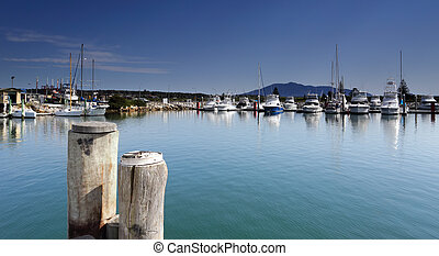 Bermagui Harbour from the promenade and Mount Gulaga in the...